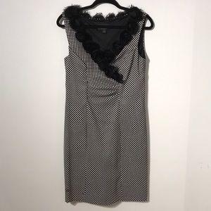 Polka dot dress with rosette flower necklace